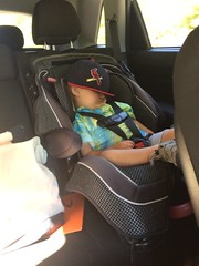 Now this is relaxed! (gregorylggregory) Tags: baby hat car relax sleep rest cardinals