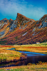 Hallehornet in autumn colors (Usstan) Tags: autumn sky mountain mountains reflection water field grass norway skyline clouds creek reflections river lens landscape norge nikon day seasons outdoor no sigma wideangle calm valley serene mountainside nikkor 187 locations sunnmre mreogromsdal rsta d7100 1685mm hallehornet romedalen
