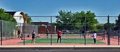 It's Tennis Time-HFF! (Jo-I Have A New Group!) Tags: blue trees red sky white black green hat kids fence court high beige pants balls chainlink tennis shirts tall protective lessons drivebyshooting outthewindow highlandhighschool takeaim fencedfriday