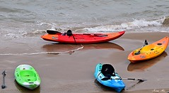 Colourful canoes (Nina_Ali) Tags: colour beach boats canoes seafront tenby habour 2016 nikond5500