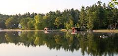 Summertime On Lake Bomoseen. (SueZinVT) Tags: lakebomoseen trees light boathouse dock reflection green water lake vermont