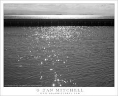 Breakwater, Bay (G Dan Mitchell) Tags: sanfrancisco california morning blackandwhite usa sun reflection water monochrome bay east sparkle northamerica breakwater