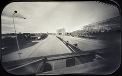 Avenue at rush hour (batuda) Tags: pinhole obscura stenope analogue tin altoids 6x9 paper kodak polymax d76 wide wideangle lithuania kaunas city akropolis mall parking parkinglot street avenue karaliausmindaugo hotel respublikos cityscape garage supermarket cars building architecture