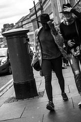 Hold on to your hats! (J Newton Photography) Tags: street city woman white man black cold canon newcastle eos post box f14 windy breezy 18135mm 60d people50mm