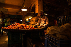 Tomato Vendor (Sauvik.Acharyya) Tags: lighting people india men vegetables look retail tomato photography market places indoor seller sauvikacharyya