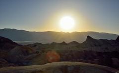 A Setting Sun Over Zabriskie Point (thor_mark ) Tags: california day2 sunset sun mountains nature unitedstates deathvalley blueskies goldencanyon zabriskiepoint desertlandscape lookingwest deathvalleynationalpark nearsunset sunsettime project365 colorefexpro erosionallandscape pixelmator tuckimountain mountainsindistance badlandformations nikond800e mountainsoffindistance amaragosarange capturenx2edited triptodeathvalleyandcalifornia westgreatbasinranges atzabriskiepoint