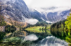 One hot mess of a mountain range. (Geolilli) Tags: trees sun snow mountains wet water strange lines rain weather fog canon reflections bavaria funny bad cover messy arrows leading abnormal obersee smokesignals lakescape