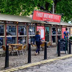 _DSF1507-Edit (richwself) Tags: uk red england urban architecture bristol cafe unitedkingdom streetphotography squarecrop tableandchairs fujinonxf1855mmf284rlmois fujifilmxpro2