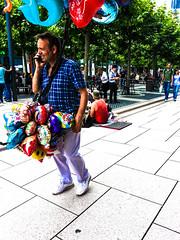 Baloon seller (yousufkurniawan) Tags: cameraphone people work baloon streetphotography worker streetphoto vendor job seller eurocup2016