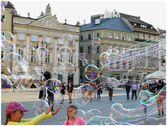 """""""Inundated"""" - Krakow, Poland (TravelsWithDan) Tags: girls play bubbles inundated townsquare oldtown krakow poland candid streetphotography outside city urban hat"""
