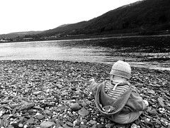 Rocks! (whitesepulchre) Tags: blackandwhite baby playing monochrome hat canon river fun happy hoodie kid rocks afternoon riverside exploring daughter rocky kind steine shore riverbank rheintal schwarzweiss fluss rhine rhein bnw amazed tochter shoal rheinlandpfalz spielen rhinevalley glcklich entertained spas blancetnoir nachmittag rhinelandpalatinate sx50 canonpowershotsx50