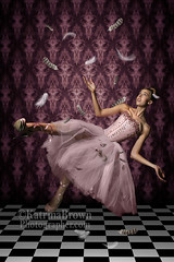 Levitation shot of a Woman and Feathers (tobkatrina) Tags: woman strange beautiful mystery female flying ballerina pretty dress creative feathers young surreal floating levitation falling fantasy corset gown distressed checkered bizarre