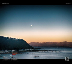 Moon Over Tranquil Water (tomraven) Tags: houses sunset sky moon mountains water boats coast glow blackberry coastal moonrise priv tomraven aravenimage q22016