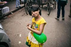 She's Cute (Yoh_click_O_maniac) Tags: life street portrait people urban india green love girl smile yellow canon photography photo photos baloon streetphotography dailylife stories kolkata