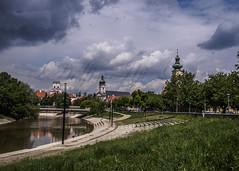 Gyr (Delfinibi) Tags: sky urban river hungary outdoor olympus crucifix ungarn zuiko g felh tavasz magyarorszg vros gyr foly mzuiko olympusm1442mmf3556iir olympusepl5