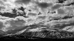 Wuthering Heights (lunaryuna) Tags: sky bw panorama sunlight snow mountains ice monochrome clouds season landscape blackwhite iceland spring lunaryuna cloudscape striations cloudshadows northiceland lightmood nordfjords seasonalwonders