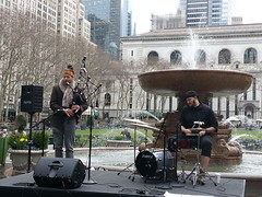 Bagpiper at Bryant Park during Tartan week in NYC (DesBphotos) Tags: nyc newyorkcity ny newyork scotland manhattan highlander highland scot bagpipes bryant bagpiper tartan bagpipe scotttish tartanweek bryantprk tartanweekscotland