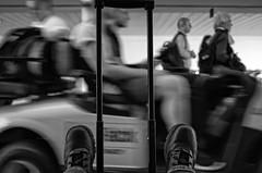 Joys of Travelling (Anne Worner) Tags: street travel people blackandwhite bw motion travelling copenhagen walking handle airport sitting boots candid streetphotography surreal depthoffield riding motionblur inside ricohgr selectivefocus shallowdof kastrupairport silverefex anneworner