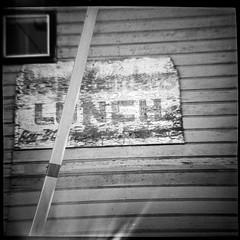 L/NCH (robert schneider (rolopix)) Tags: sanfrancisco california ca blackandwhite bw blur 120 film broken monochrome sign wall mediumformat square store 4x4 toycamera calif lightleak diana faded ilford fp4 plasticcamera fp4plus diana151 120620 robertschneider autaut bwfp believeinfilm rolopix