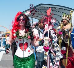 Ace of Hearts Mermaid (UrbanphotoZ) Tags: nyc newyorkcity flowers ny newyork green brooklyn hearts coneyisland cards women photographer tail staff crown bodice mermaid mermaidparade sequins crooked aliceinwonderland spilling heartglasses coneyislandmermaidparade aceofhearts redandblackhair coffeecupheadpice