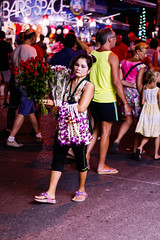 Flowers without a smile (Mussi Katz) Tags: street flowers red roses lady walking thailand poor phuket bangala