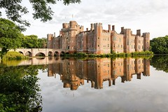 Herstmonceux Castle in the morning (ejwwest) Tags: england reflection brick castle sussex britain drawbridge moat herstmonceux