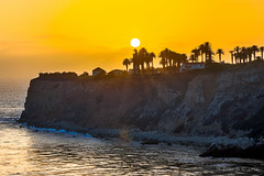 Sun setting over Point Vicente Lighthouse (ScorpioOnSUP) Tags: ocean sunset sky cliff beach clouds rocks waves bluesky ranchopalosverdes pointvicentelighthouse pelicancove