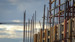 Scaffolding in the Sky (Theen ...) Tags: wood red sky building yellow electric metal clouds lumix grey evening construction rust scaffolding cables adelaide rods reinforcement theen kenttown littlerundlestreet
