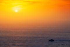 De vuelta a puerto (Mimadeo) Tags: ocean sunset red sea sky orange seascape color water beautiful sunrise landscape golden evening boat ship dusk vessel calm fishingship