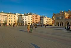 Morning walk along the Main Square (madejski.janusz) Tags: city travel tourism church st architecture basilica arcade poland medieval historic unesco marys lanterns krakw marketsquare dothhall