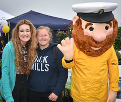 RNLI Mascot and the Girls (littlestschnauzer) Tags: honley show rnli mascot yellow girls smiling huddesfield west yorkshire uk lifeboat june 2016 countryside agricultural rural meet greet fun crew boat sea seaman sailor