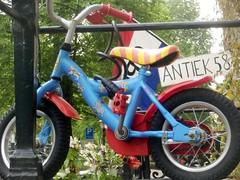 Antiek 58 (Quetzalcoatl002) Tags: street amsterdam bicycle sign shop kids children streetshots streetculture antiek kinderfiets