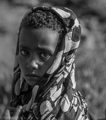 Schoolgirl in Ethiopian Village (Peraion) Tags: africa portrait blackandwhite face headscarf ethiopia schoolgirl