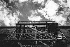 A view from beneath. (camiladellnogues) Tags: building blackandwhite contrast old sky monochrome clouds stairs bricks metal windows perspective shadow architecture nikon nikond7200 d7200 canada vancouver downtown bc