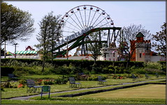 Southport Pleasureland (* RICHARD M (Over 5 million views)) Tags: southportpleasueland themepark fairground funfair ferriswheel bigwheel fun scapes bowlinggreen benches kingsgardenssouthport seasideresorts holidayresorts resorts southport sefton merseyside flowerbeds trees shrubbery spring springtime may fairgroundrides funfairrides