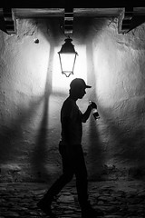 Under the Light (Gigin - NoDigital) Tags: light people man hat wall buildings colombia parts objects places clothes geography locations villadeleyva centralandsouthamerica