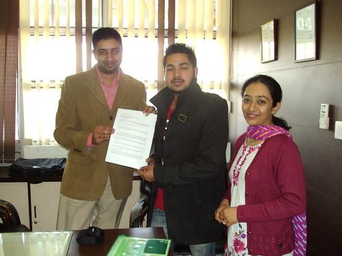 Sant Prakash receiving Australia Study visa from counselor