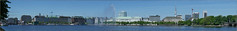 Hamburg, Friday 13th, the sunny side, still under construction (/Reality Scanner/) Tags: city trees houses sky urban panorama lake water fountain skyline architecture germany boats deutschland lumix town spring wasser ships hamburg sightseeing himmel sunny panasonic stadt architektur boardwalk ufer alster sonnig bume touristic frhling huser fontne gm5 touristsview