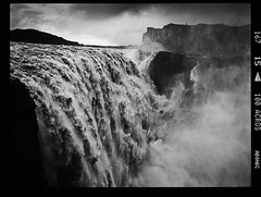 Turn (tsiklonaut) Tags: world travel people bw cliff white black 120 film blanco monochrome analog dark landscape island rising mono waterfall iceland 645 fuji y drum scanner ngc negro watching dramatic scan steam experience roll fujifilm medium format 100 analogue foss 6x45 juga powerful analogica dettifoss discover acros icelandic mustvalge vatnajkull drumscan analoog pmt maastik ga645i kosk photomultipliertube keskformaat