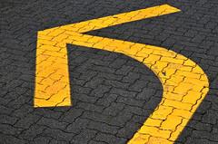 Go Left (James_D_Images) Tags: road brick sign yellow vancouver pavement britishcolumbia direction arrow granvilleisland left