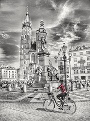 Best way to see the world, on your bike. (kriswoods2322) Tags: krakow poland city medieval bike people marketsquare oldtown historical
