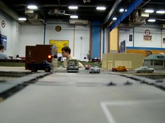 Santa Fe freight @ grade crossing (Chicago Rail Head) Tags: santafe 1950s trackside hogauge emd modeltrainshow 187scale ftunits modeltrainaction firstfreightdiesels modelrailroadvideo