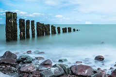 Passing ships... (Photography by Julia Martin) Tags: longexposure sea seaweed yacht horizon peaceful pebbles seashore groynes fenceposts wavebreaker supershot leefilter passingships northsomersetcoast 61seconds canon5dmarkiii leendgrad06 leendgradfilter leebigstopper photographybyjuliamartin canon1635mmf4is