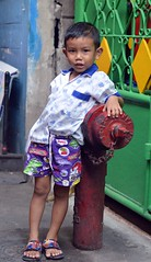 boy leaning on a fire hydrant (the foreign photographer - ) Tags: boy red portraits hydrant thailand fire nikon bangkok bang leaning bua khlong bangkhen d3200 apr92016nikon