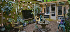 Summertime Courtyard (BKHagar *Kim*) Tags: bkhagar courtyard fence wall plant plants art riversong face pottery hanging outdoor copper kitchenmolds glassgardenhouse leadedglasswindows stainedglass vintage antique fountain inexplore explore