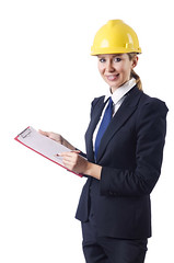 Image of Businesswoman with helmet on white (som.davarya) Tags: hardhat people white building industry yellow architecture female writing work project person site clothing construction industrial adult head helmet hard engineering gear tools wear safety professional equipment architect stop worker vest protective collar manager job protection contractor signing engineer isolated builder workman carpenter profession binder caucasian occupation repairman foreman businesswoman