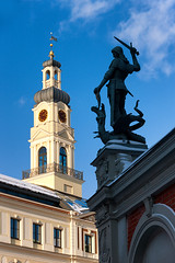 Sculpture with a sword at the Town Hall Square in Riga (Viktor Descenko) Tags: old city travel urban sculpture house building history tourism monument statue vertical architecture square town hall europe downtown european exterior symbol famous capital gothic landmark center baltic medieval historic latvia weapon roland figure sword knight historical shield marble riga latvian blackheads