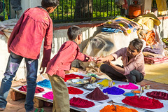 Buying Colors (Gigin - NoDigital) Tags: boy people india man colors kid colorful asia geography khajuraho