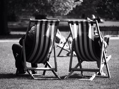 Deck Chairs (Feldore) Tags: park shadow two england sun white black london english sunshine silhouette sitting chairs olympus panasonic deck argument behind mchugh striped deckchairs em1 dispute 35100mm feldore