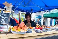 Framed (jimj0will) Tags: woman fish market lobster colourful seller odc